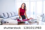 happy woman housewife ironing... | Shutterstock . vector #1281011983