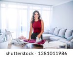 happy woman housewife ironing... | Shutterstock . vector #1281011986