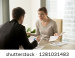 Small photo of Angry businesswoman arguing with businessman about paperwork failure at workplace, executives having conflict over responsibility for bad work results, partners disputing about contract during meeting