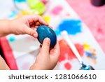 child holding freshly colored... | Shutterstock . vector #1281066610