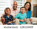 portrait of family sitting on... | Shutterstock . vector #128110409
