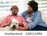 happy senior couple sitting on... | Shutterstock . vector #128111096