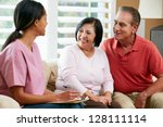 nurse making notes during home... | Shutterstock . vector #128111114