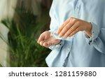woman using antibacterial hand...   Shutterstock . vector #1281159880