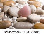 rose quartz heart on pebbles. | Shutterstock . vector #128126084