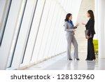 two businesswomen having... | Shutterstock . vector #128132960