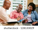 financial advisor talking to... | Shutterstock . vector #128133029