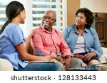 nurse making notes during home... | Shutterstock . vector #128133443