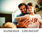 father and daughter using...   Shutterstock . vector #1281363169