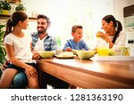 happy family interacting while... | Shutterstock . vector #1281363190