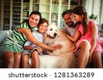 family with dog sitting on sofa ... | Shutterstock . vector #1281363289