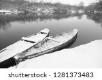 boats on the shore of the snowy ... | Shutterstock . vector #1281373483