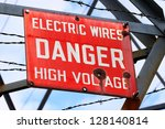Danger Sign On A Powerline...