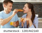 man and woman in the kitchen... | Shutterstock . vector #1281462160