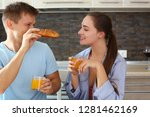 man and woman in the kitchen... | Shutterstock . vector #1281462169