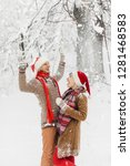 couple in love lie in the snow ... | Shutterstock . vector #1281468583