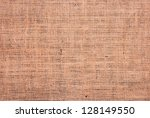 Fragment of rough brown textile background - stock photo