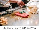 chef cook beef steak for the... | Shutterstock . vector #1281545986