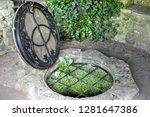 Small photo of The Chalice Well, also known as the Red Spring, is a well situated at the foot of Glastonbury Tor Somerset, England. The natural spring the water is reputed to possess healing quality.