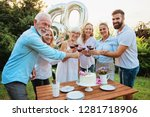 family celebrating a  60th... | Shutterstock . vector #1281718906