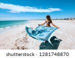 girl relaxing on the beach ... | Shutterstock . vector #1281748870