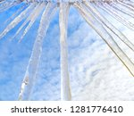 icicles hanging from the edge... | Shutterstock . vector #1281776410