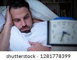 stressed sleepless man... | Shutterstock . vector #1281778399