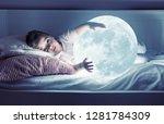little girl holding the moon ...   Shutterstock . vector #1281784309