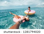 mom with child chilling on lilo ... | Shutterstock . vector #1281794020