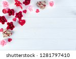 Stock photo wooden white background with red hearts gifts and candles the concept of valentine day flat lay 1281797410