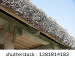 reed roof of an old wooden... | Shutterstock . vector #1281814183