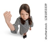 Small photo of Bad girl showing a big fist and grumpy face. Kid with awful temper and unfriendly attitude.
