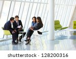 businesspeople having meeting... | Shutterstock . vector #128200316