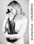 woman hold a violin in her arms ... | Shutterstock . vector #1282008043