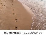 footprints on the beach | Shutterstock . vector #1282043479