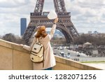 trip across europe. girl with a ... | Shutterstock . vector #1282071256