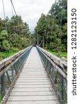 suspended bridge  lake matheson ...   Shutterstock . vector #1282123150