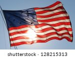American Flag Waving In Front...