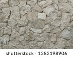 old grey stone wall background... | Shutterstock . vector #1282198906