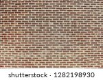 old red brick wall background... | Shutterstock . vector #1282198930