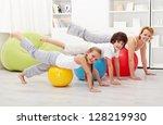 People doing stretching exercises using gymnastic balls - stock photo