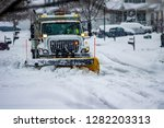 White Snowplow Truck With...
