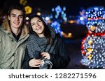 night portrait of a happy... | Shutterstock . vector #1282271596