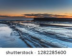 bold and dramatic sunrise...   Shutterstock . vector #1282285600