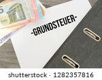 euro banknotes and a folder... | Shutterstock . vector #1282357816