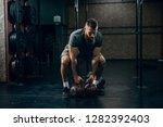 muscular attractive caucasian... | Shutterstock . vector #1282392403