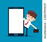 businessman talking beside big... | Shutterstock .eps vector #1282394419