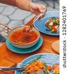pumpkin soup with cream   Shutterstock . vector #1282401769