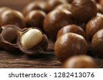 roasted macadamias on wooden... | Shutterstock . vector #1282413076