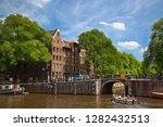 amsterdam   july 10  canals of... | Shutterstock . vector #1282432513